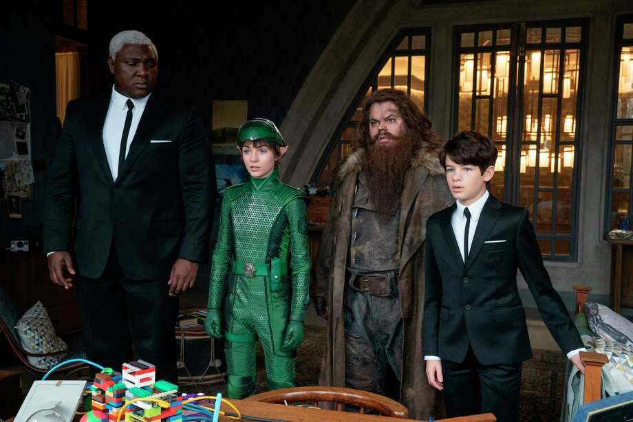 "This image released by Disney Plus shows, from left, Nonso Anozie, Lara McDonnell, Josh Gad and Ferdia Shaw in a scene from ""Artemis Fowl."" (Disney via AP) Photo: Associated Press / Disney Plus"