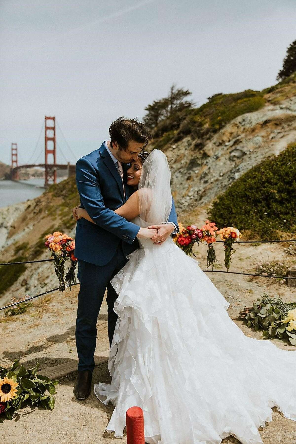 Divya Dhar Cohen and Jack Cohen at their May 2020 wedding in San Francisco. Despite the shelter-in-place order, which kept them from having their friends and families with them, they orchestrated a virtual wedding with 200 guests logging in to celebrate.