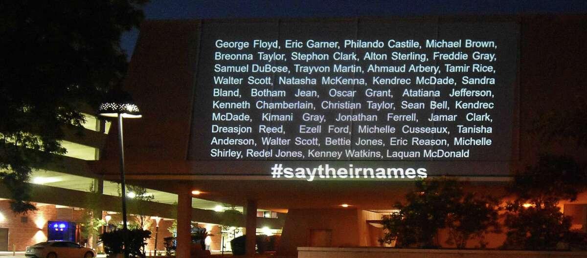 Photographer Angela Martinez has been projecting Black Lives Matter messages against buildings across San Antonio.