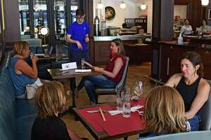 Patrons sit in tables spaced at least six feet apart in Morrissey's restaurant located on Broadway on Wednesday, June 17, 2020 in Saratoga Springs, N.Y. Today started phase three in the Capital District where indoor dining is now allowed with certain safety restrictions. (Lori Van Buren/Times Union)