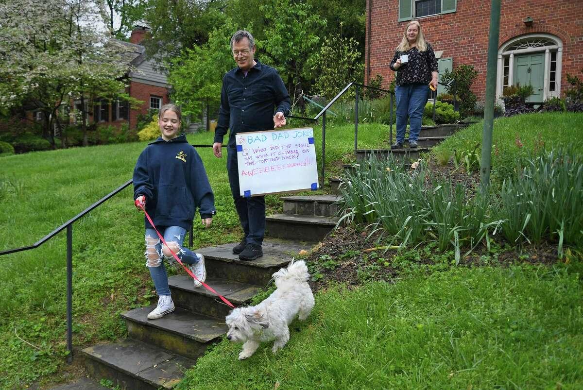 Darcy Schruben, Joey, Tom Schruben Ann Schruben make their way to the curb to post the daily bad dad joke in Kensington, Md., on May 1, 2020.