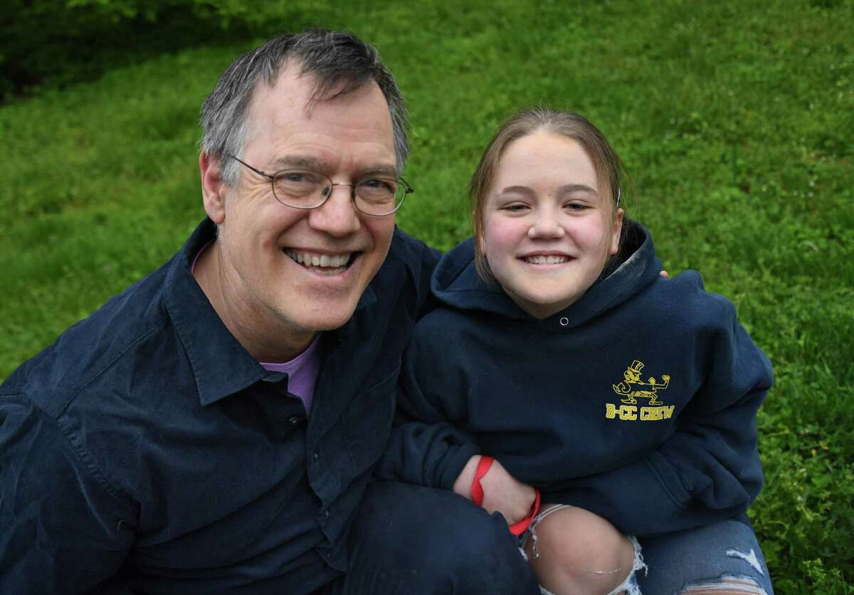 Tom Schruben and his daughter Darcy pose in Kensington, Md., on May 1, 2020.