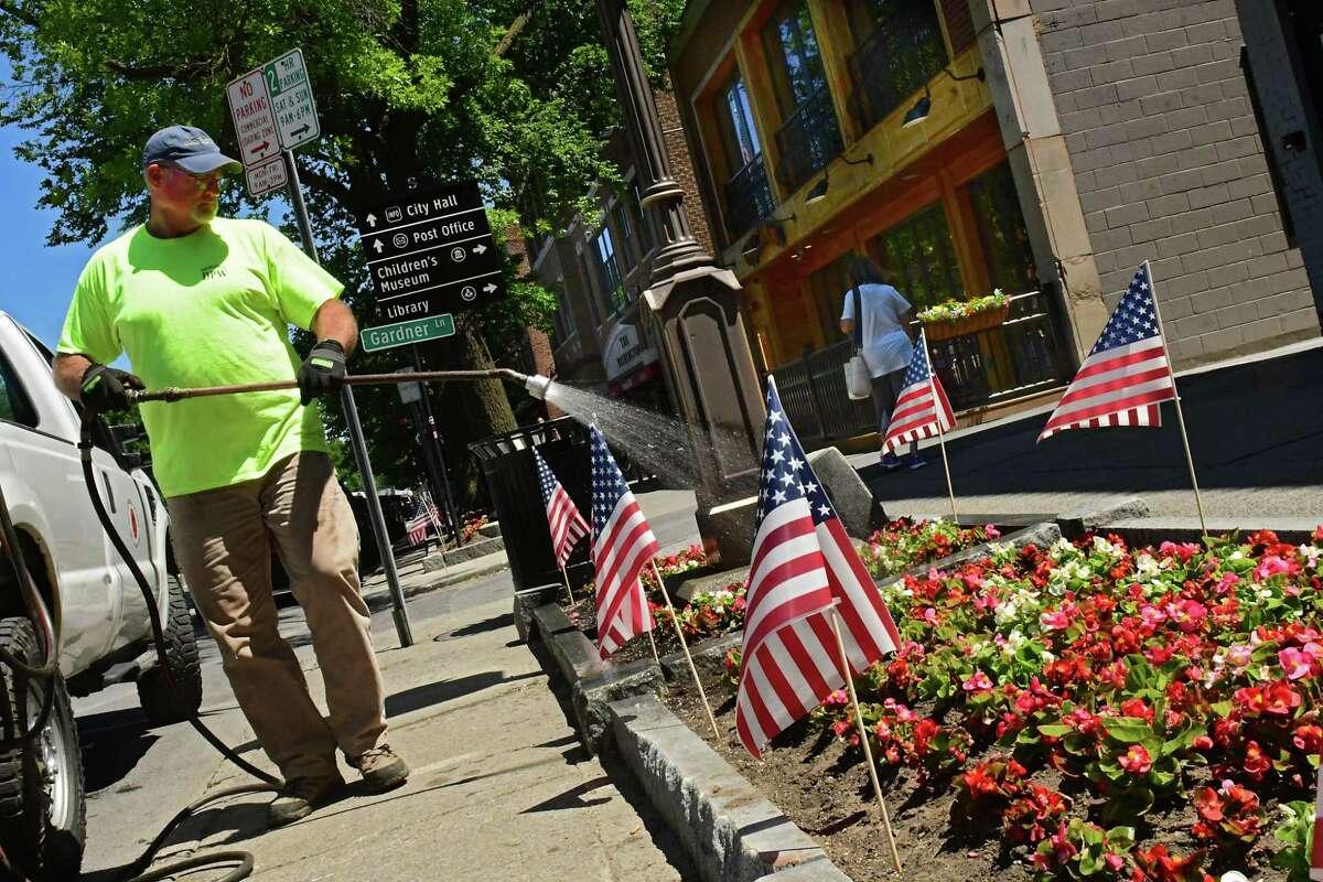 Department of Public Works employee Rob Wheelock waters flower beds along Broadway on Wednesday, June 17, 2020 in Saratoga Springs, N.Y. (Lori Van Buren/Times Union)