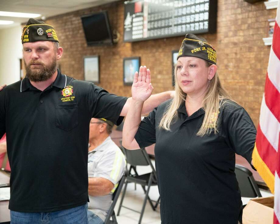 "The Veterans of Foreign War Post 4709 in Conroe has elected its first female commander. Commander Raquel ""Kelly"" Glass stands next to Senior Vice Adam Black as she was sworn into her new leadership role on June 3 at the post. Photo: Submitted Photo / Submitted Photo / constance mcnabb dvm"
