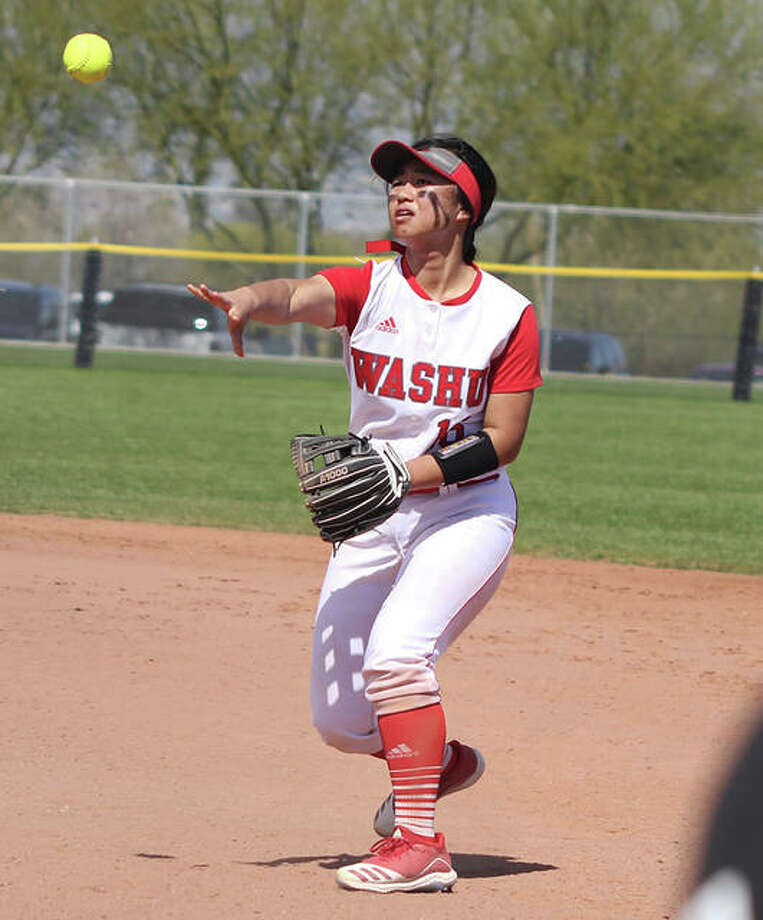 Washington University second baseman Tami Wong throws to first base for an out during a Bears game this spring. A freshman from Alton, Wong was hitting a team-leading .500 before Wash U's season was ended after a 6-3 start. Photo: Wash U. Athletics