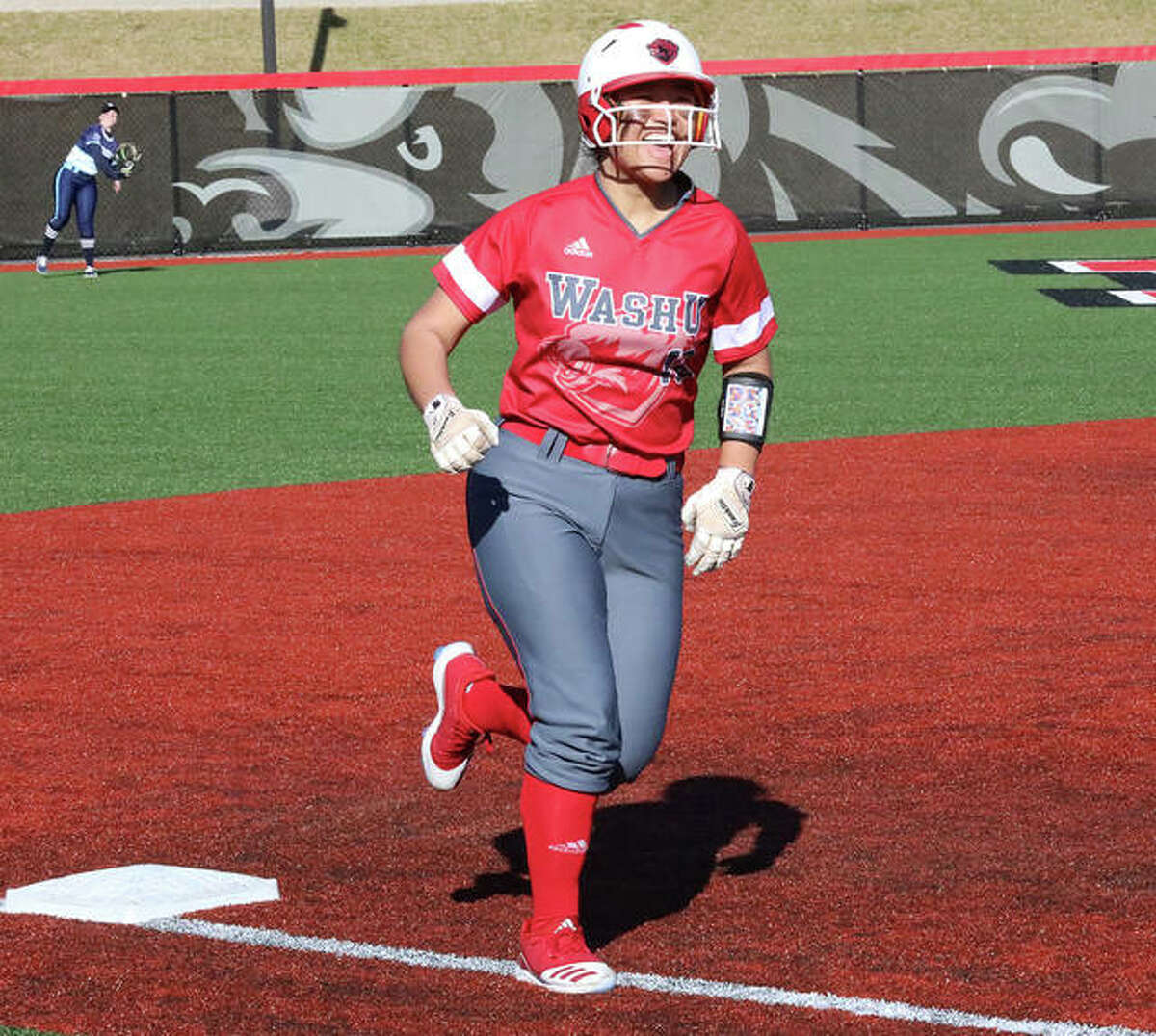 Wash U freshman Tami Wong rounds third base and heads home with a smile after hitting a home run against Westminster in her second college game Feb. 29 at Maryville University in St. Louis.