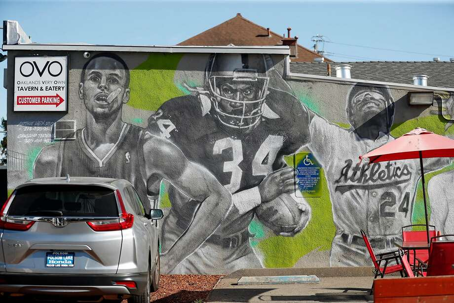A mural next to OVO in Oakland features Bay Area athletes. Photo: Scott Strazzante / The Chronicle 2018