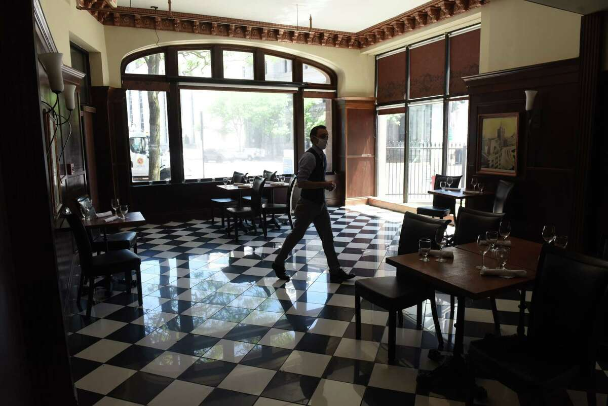 Tables are spaced apart at Jack's Oyster House to comply with the state's phase three reopening plan on Wednesday, June 17, 2020, in Albany, N.Y. Capital Region restaurants were able to open for indoor dining Wednesday under coronavirus safety guidelines. (Will Waldron/Times Union)