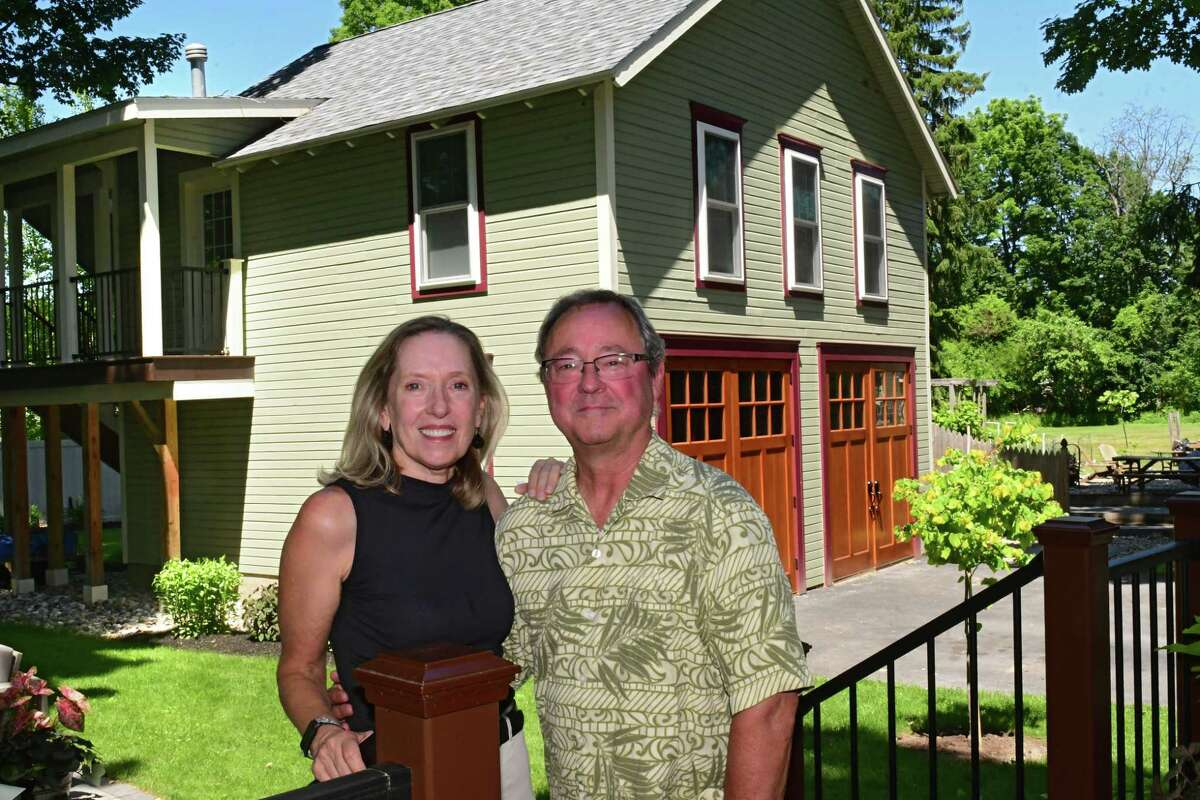Alison Rhodes-Devey and her husband Mark Hodge stand in front of the carriage house they renovated on their property to use as an Airbnb rental on Wednesday, June 17, 2020 in Saratoga Springs, N.Y. (Lori Van Buren/Times Union)