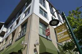 "BERKELEY, CA - JUNE 15: A ""now leasing"" sign is posted in front of the Fourth and U apartments on June 15, 2012 in Berkeley, California. According to a report by Harvard University's Joint Center for Housing Studies, the tepid real estate market could see a turnaround with the price of rental properties surging and vacancies dropping from 10.6 percent in 2009 to 9.5 percent last year, the lowest level since 2002. (Photo by Justin Sullivan/Getty Images)"