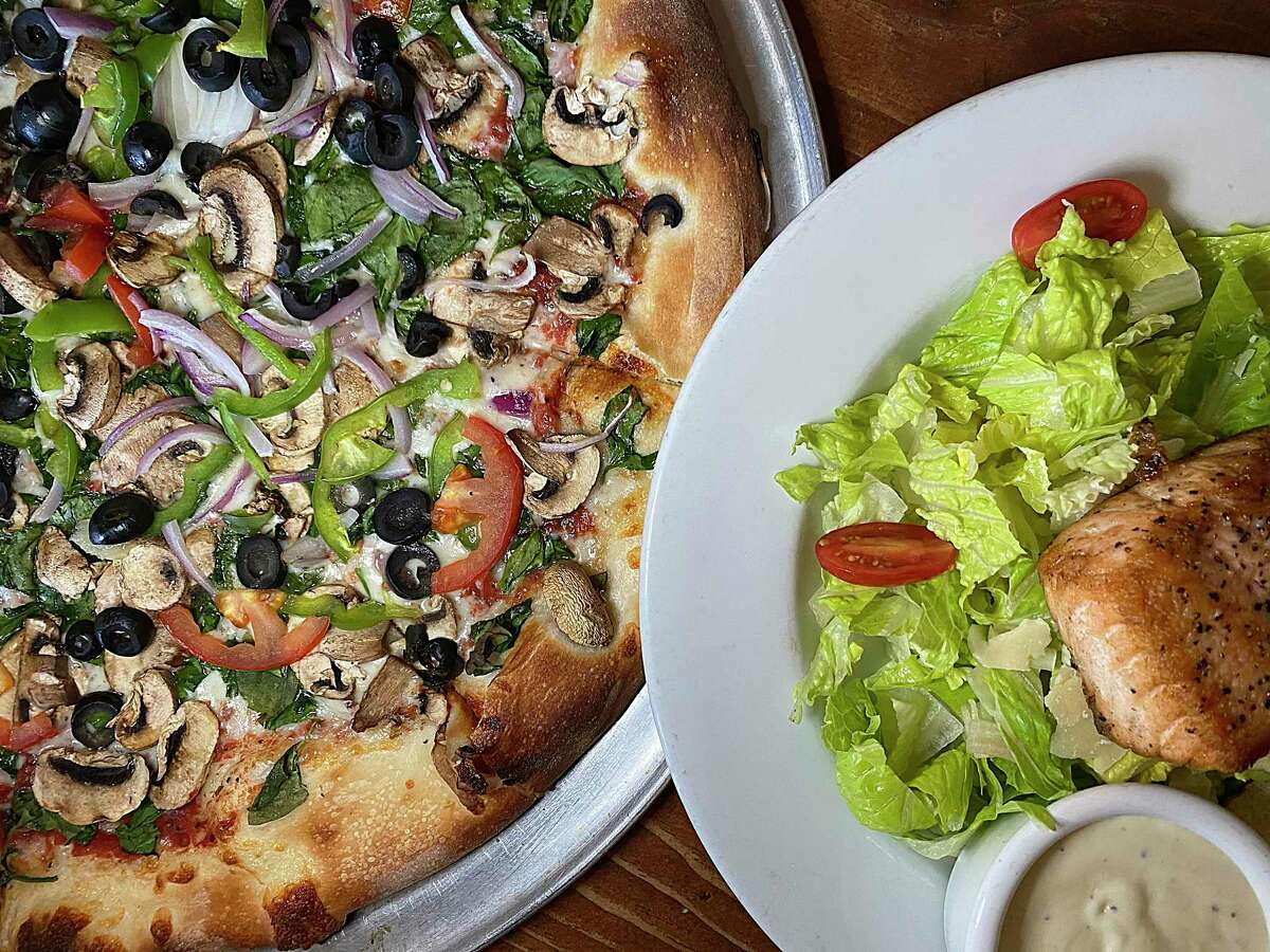Pizza options at Southtown Pizzeria include the Veggie with spinach, mushrooms, tomatoes, olives, bell peppers and onions. Salad choices include a Caesar with grilled salmon.