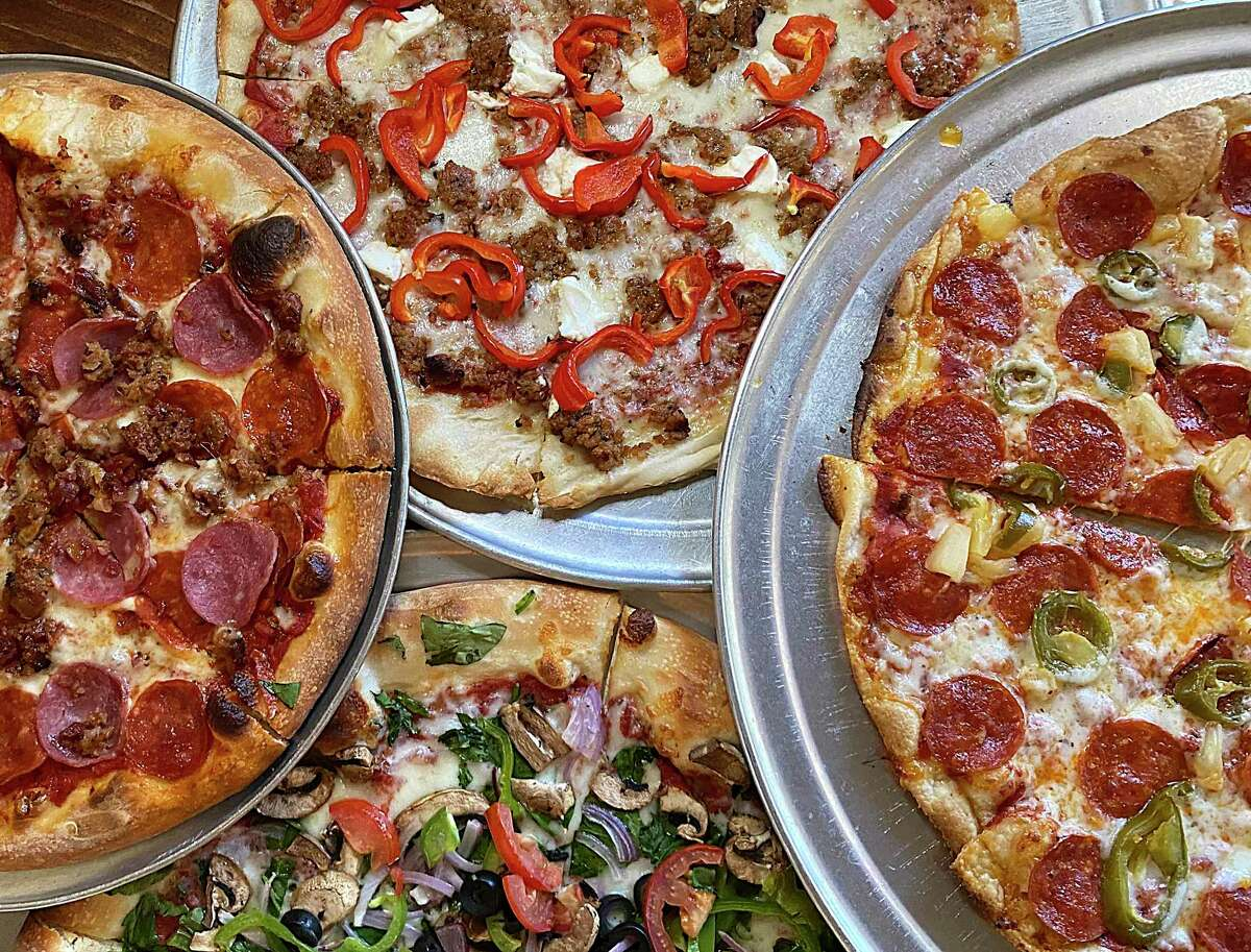 Pizza options at Southtown Pizzeria include, clockwise from left, the Meat Lovers; a custom pie with ricotta, red pepper and sausage; the Southtown; and the Veggie.