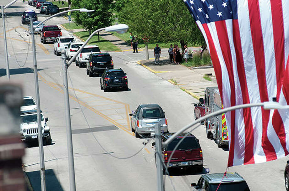 Friends and community members turned out Wednesday to remember Morgan County Treasurer Jenny Geirnaeirt, who died in a car accident Friday. Following her funeral, there was a procession along the streets of Jacksonville, many of which were lined with people paying their respects. Photo: Darren Iozia | Journal-Courier