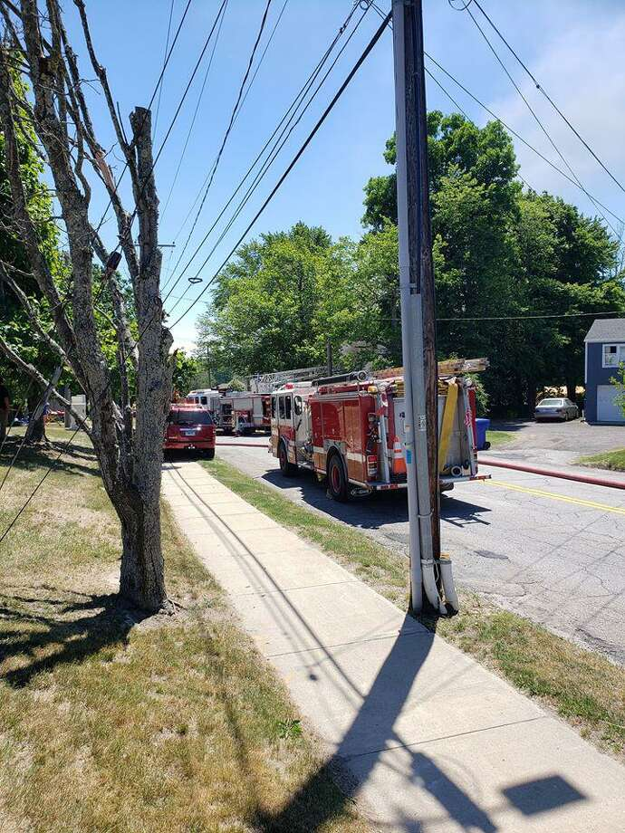 Units on scene for a house fire in the area of Torringford West Street and East Main Street in Torrington, Conn., on Wednesday, June 17, 2020, around 2:15 p.m. Photo: Contributed Photo / Torrington Police Department