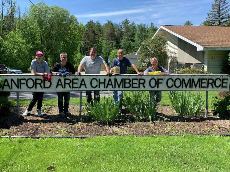 MBA staff membersassist with the cleanup of the Sanford Area Chamber of Commerce offices. (Photo provided)