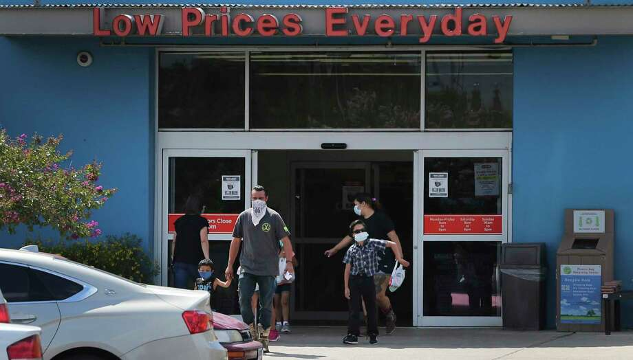 Customers at H-E-B on West Avenue sport masks as they leave the store. Photo: Kin Man Hui /Staff Photographer / **MANDATORY CREDIT FOR PHOTOGRAPHER AND SAN ANTONIO EXPRESS-NEWS/NO SALES/MAGS OUT/ TV OUT