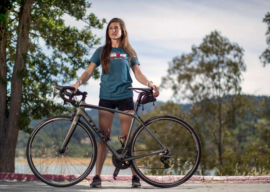 Triathlete Katie Swanson, who survived COVID-19 after contracting the disease in February, is seen near one of her favorite training areas near Lexington Reservoir in Los Gatos. Photo: Carlos Avila Gonzalez / The Chronicle