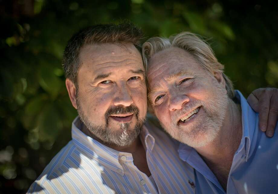 Spouses Martin and Kevin Jones of Oakland, together for 34 years, survived COVID-19 as well. Photo: Carlos Avila Gonzalez / The Chronicle