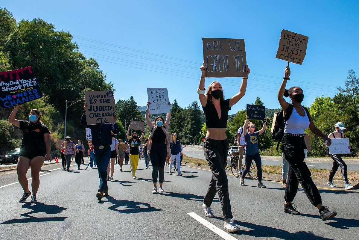 Demonstrators march onto a Hwy 101 overpass during a protest organized by a group of young people to support Black Lives Matter on June 16, 2020 in Mill Valley, Calif.