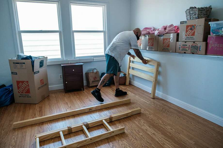 """Victor Hernandez with Shamrock Moving and Storage moves a client's belongings into a house in San Francisco on Wednesday. April was a """"lost month,"""" Shamrock's Bobby Fallon said, but business is picking up now. Photo: Nick Otto / Special To The Chronicle"""