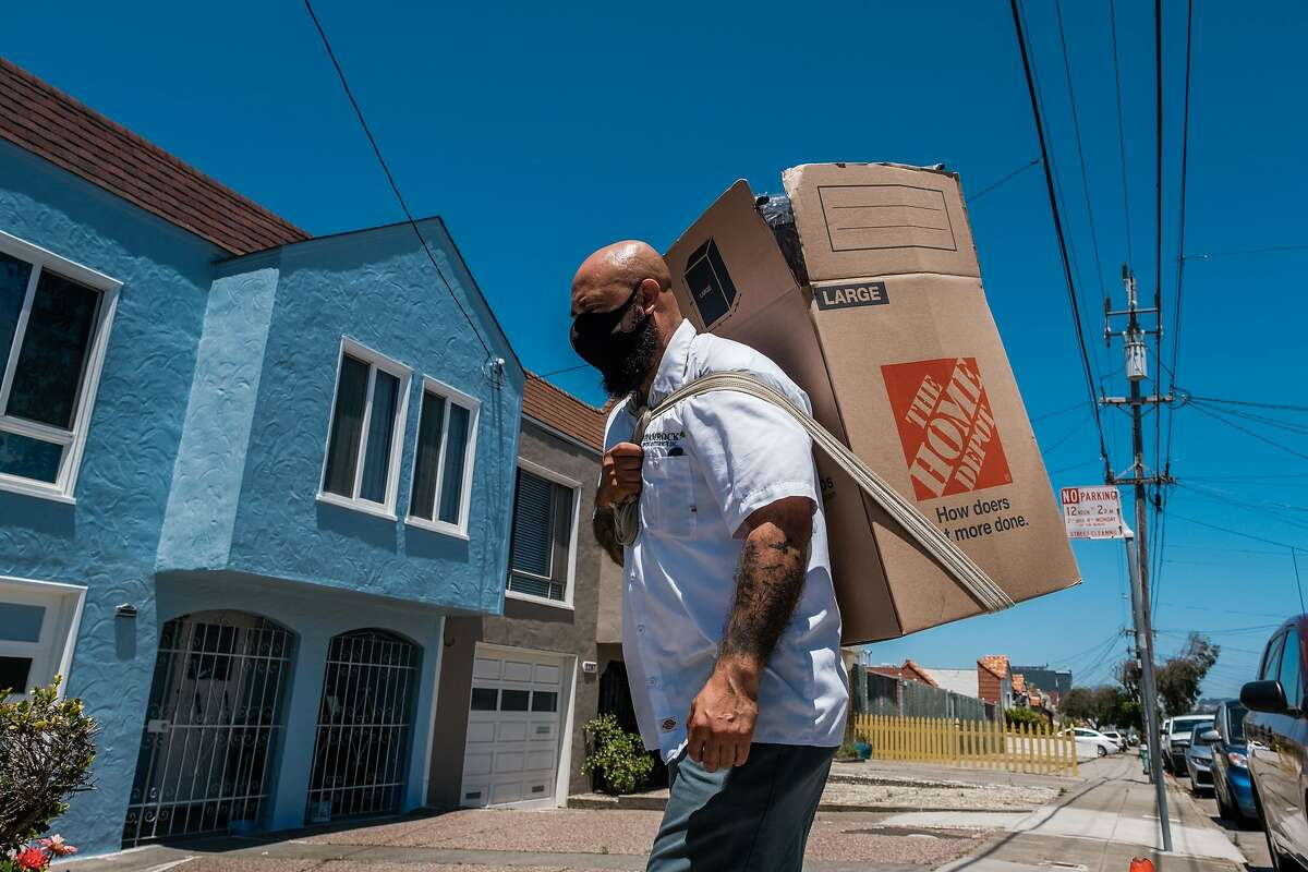 Victor Hernandez with Shamrock Moving and Storage moves a client's belongings into a house in San Francisco on Wednesday, June 17, 2020. New data from the United States Postal Service shows a large number of S.F. residents moved to other locations in the city during 2020.