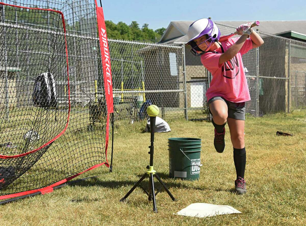 Alana Shepard, 10, practices her swing hitting balls into a net as the Miss Shen softball program holds batting practice for the 10-and-under travel team at Clifton Common on Wednesday, June 17, 2020 in Clifton Park, N.Y. The players are getting closer to a resumption of their season in July. (Lori Van Buren/Times Union)