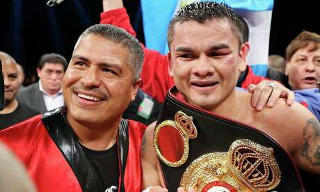 "Trainer Robert Garcia (left) and Marcos Maidana are all smiles after Maidana's WBA welterweight fight against Adrien Broner as part of the ""Danger Zone"" boxing card on Dec. 14, 2013 at the Alamodome. Maidana won by unanimous decision."