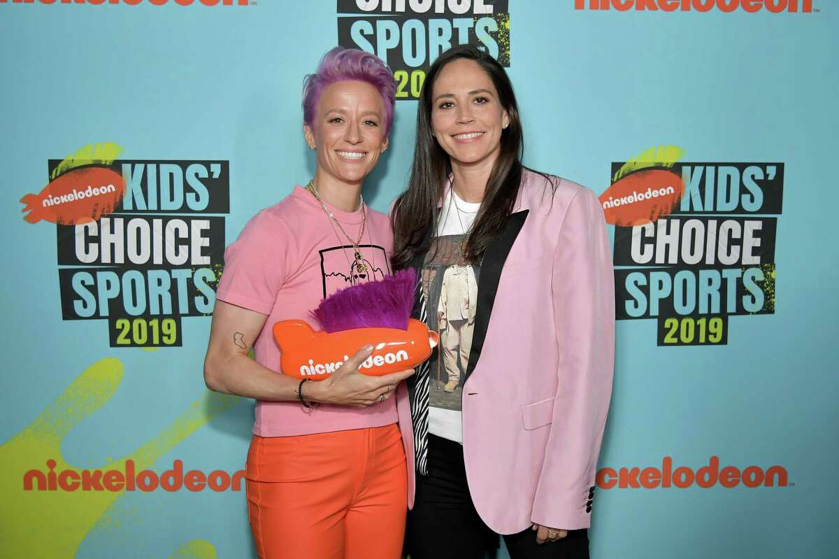 Megan Rapinoe, winner of the Generation Change award, and Sue Bird attend Nickelodeon Kids' Choice Sports 2019 at Barker Hangar on July 11, 2019 in Santa Monica, California.
