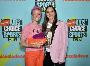 Megan Rapinoe, winner of the Generation Change award, and Sue Bird attend Nickelodeon Kids' Choice Sports 2019 at Barker Hangar on July 11, 2019 in Santa Monica, California.