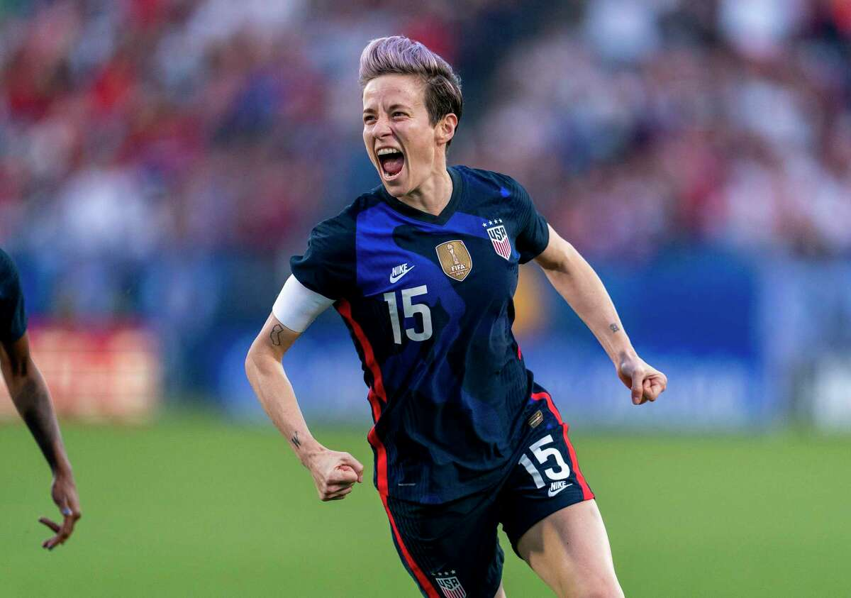 Megan Rapinoe #15 of the United States celebrates during a game between Japan and USWNT at Toyota Stadium on March 11, 2020 in Frisco, Texas. Rapinoe has used her platform as an openly gay athlete to promote discussions about social justice and has garnered headlines of her own for kneeling in solidarity with former San Francisco 49ers quarterback and civil rights activist Colin Kaepernick. She also has used her voice to call for gender equality by joining her team in calling on the U.S. Soccer Federation to change the wage discrimination between the women's and men's teams.