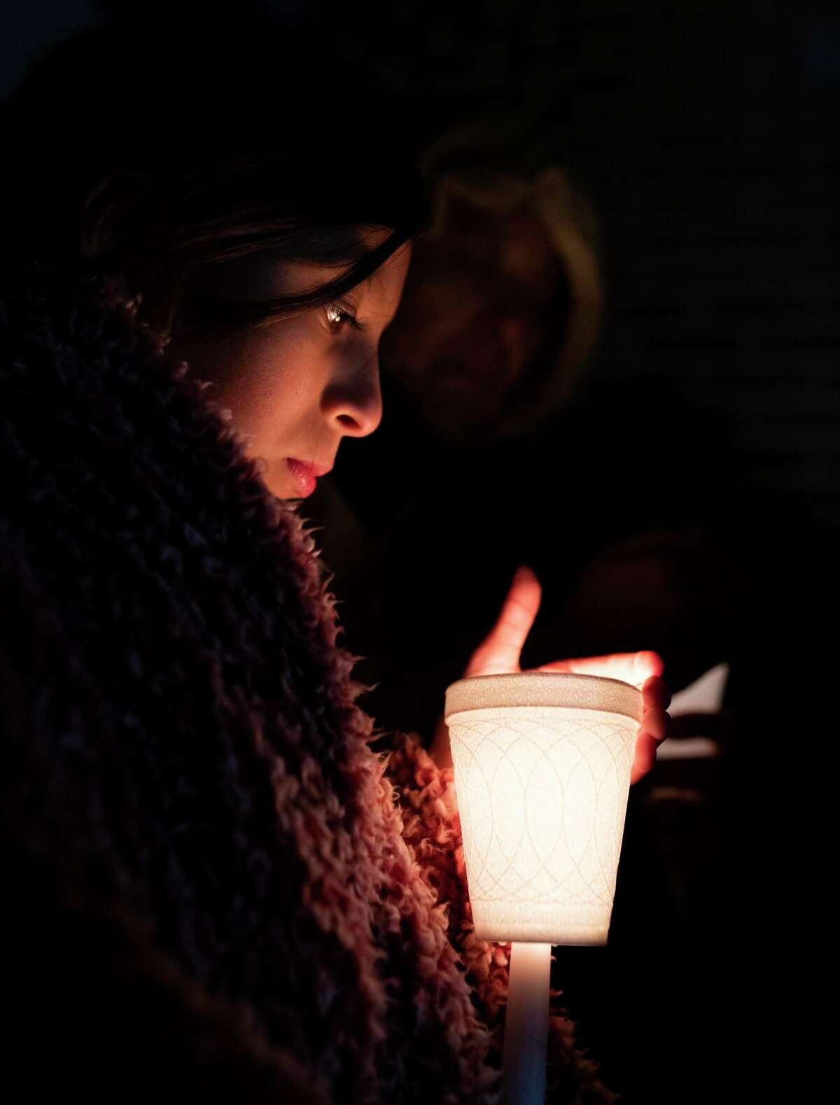 Shael Torres, 11, attends a vigil organized by The Texas Organizing Project at St. Agnes Catholic Church in San Antonio tonight in support DACA recipients and immigrant families on Monday, Nov. 11, 2019. Tomorrow the U.S. Supreme Court will hear arguments on the termination of DACA and will decide whether to uphold or strike down the program.