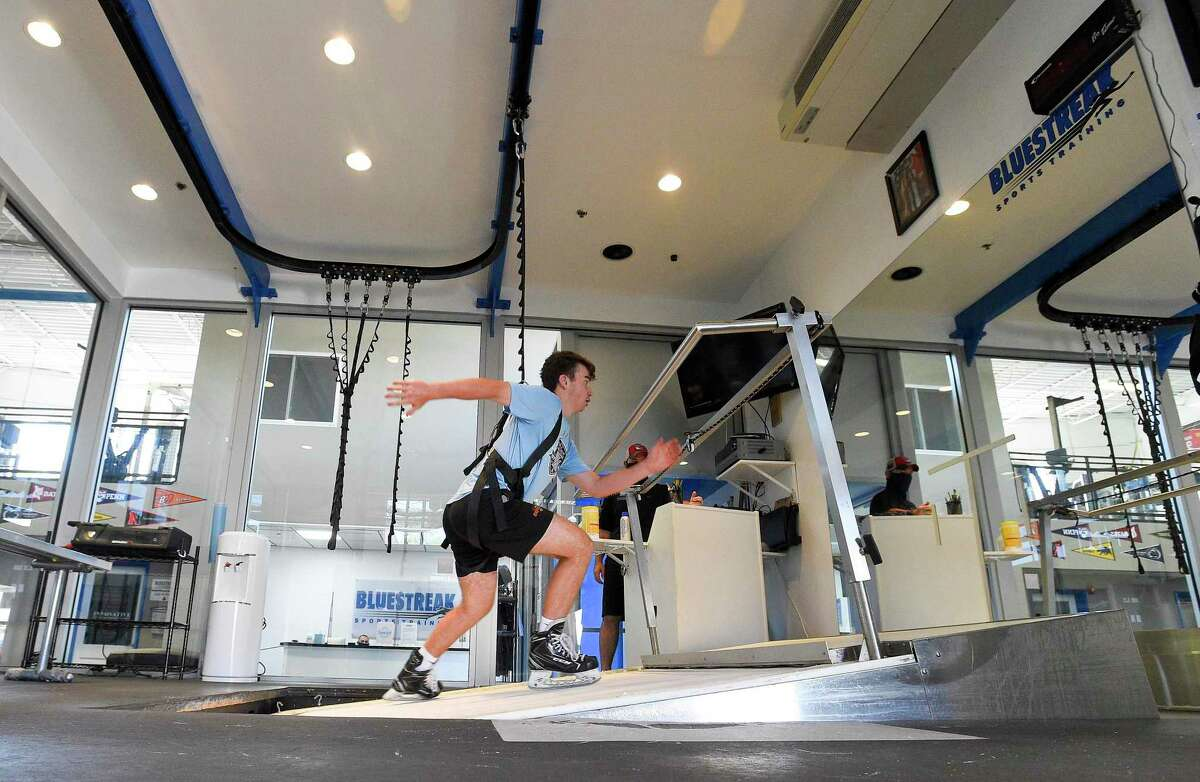Daniel McKiernan, 16, of Weston does reps on an ice skate incline treadmill at Blue Streak Sports Training. The training facility in Stamford, Connecticut held a soft reopening on June 17, 2020, to tweak and make any adjustments needed in the gyms reconfigured set up to meet the states COVID 19 safety guidelines.