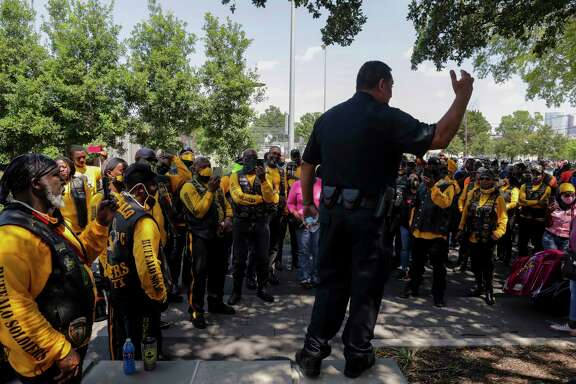 Houston Police Chief Art Acevedo talks to motorcyclists at the ride for justice honoring George Floyd on Sunday at Emancipation Park.
