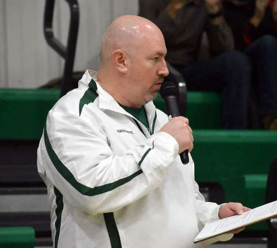 Metro-East Lutheran athletic director Jason Batty introduces line-ups before the start of a girls basketball game inside Thomas Hooks Gymnasium in Edwardsville. Photo: Intelligencer Sports Staff