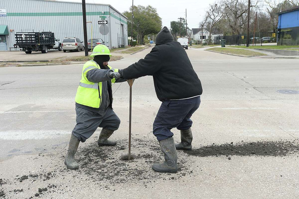 Workers with the City of Beaumont Water Department shut off the water to a block on Gulf Street after a pipe burst outside of Tiger Industries Tuesday. Photo taken Tuesday, January 2, 2018 Kim Brent/The Enterprise