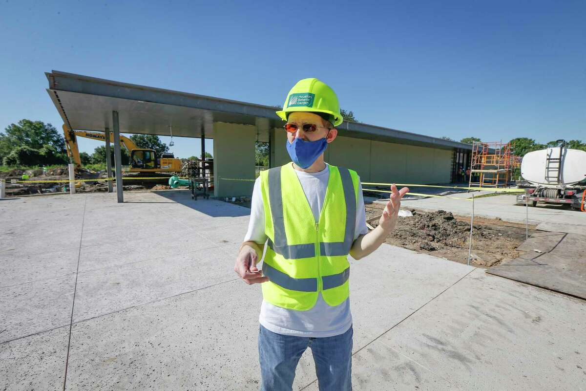 Justin Lacey, Houston Botanic Gardens' director of communications and community engagement, stands outside the Visitors Center during construction.