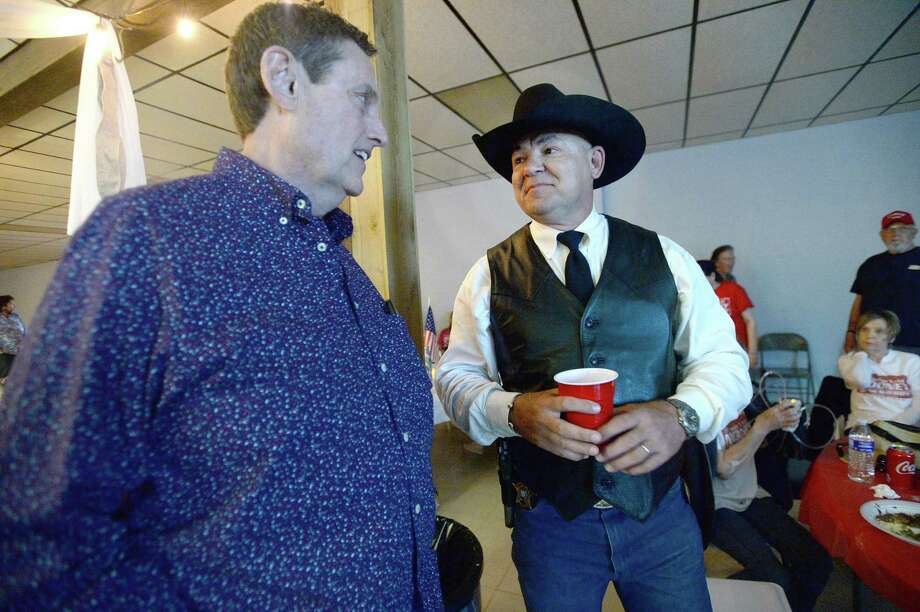 Orange County Sheriff candidate Jimmy Lane Mooney talks with Riley Nash as they await results during his watch party Tuesday night in Vidor. Photo taken Tuesday, March 3, 2020 Kim Brent/The Enterprise Photo: Kim Brent / The Enterprise / BEN