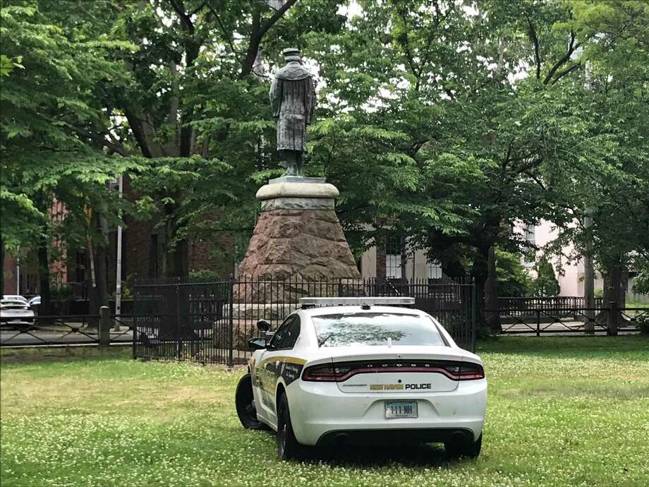A New Haven Police Department cruiser is stationed near the statue of Christopher Columbus in Wooster Square Park on June 15, 2020. Photo: Brian Zahn Hearst Connecticut Media