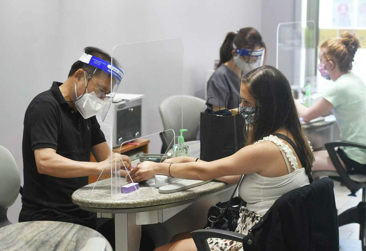 Scarsdale, N.Y. resident Jordan Tuchman gets her nails done by James Lee on the first day of reopening at Avenue Nails in Greenwich, Conn. Wednesday, June 17, 2020. Wednesday began phase 2 of reopenings in Connecticut that include nail salons, gyms, limited indoor dining, pools, tattoo parlors and more.