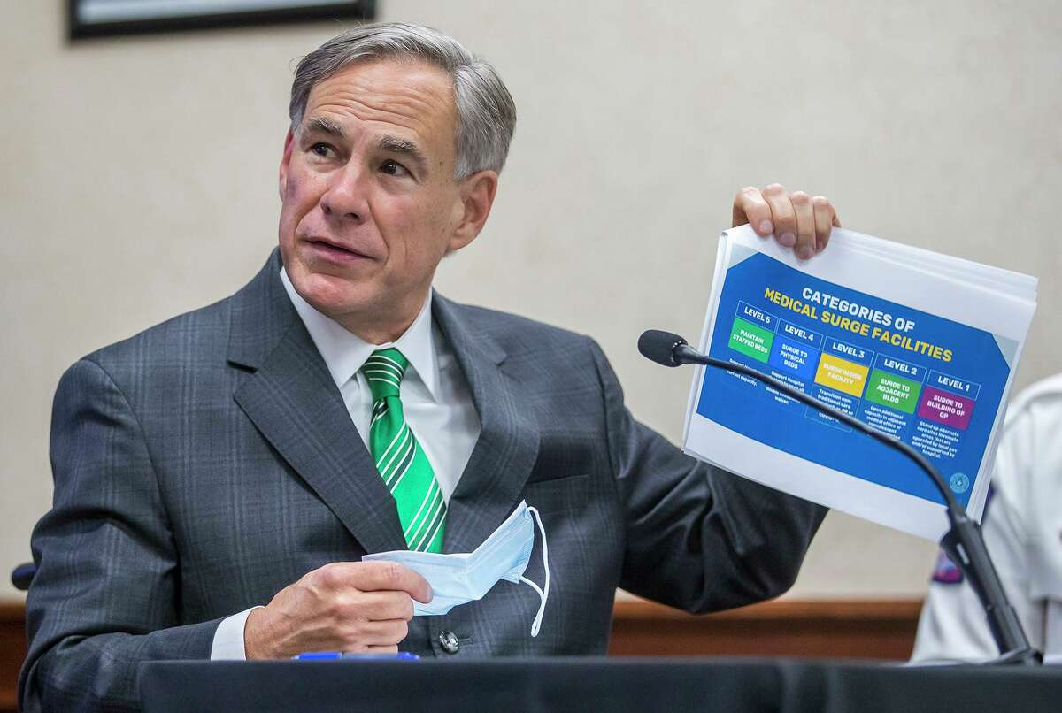 Texas Gov. Greg Abbott speaks about the categories of medical surge facilities and Level 5 of maintaining staffed beds during a press conference at Texas Department of Public Safety, Tuesday, June 16, 2020, in Austin, Texas. (Ricardo B. Brazziell/Austin American-Statesman via AP)