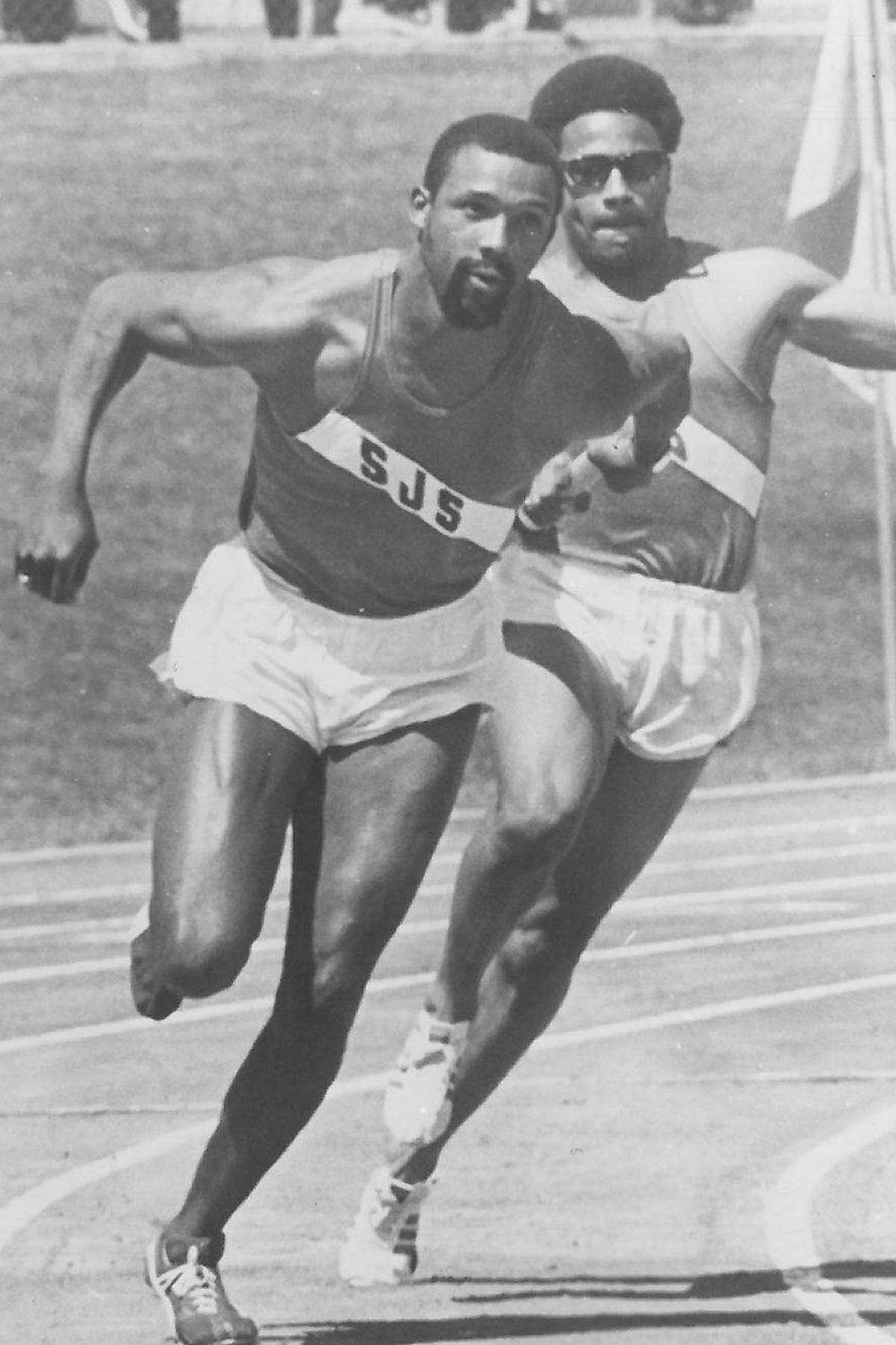 San Jose State's Ronnie Ray Smith passes the baton to John Carlos in a Bay Area meet in the late 1960s or early 1970s.