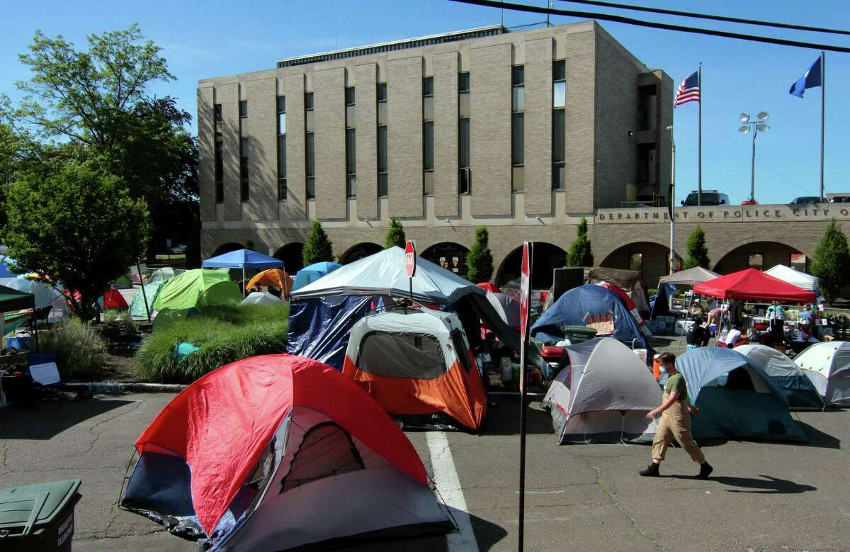 Dozens of protestors are living in a tent city in front of police headquarters on Congress Street in Bridgeport, Conn., on Wednesday June 17, 2020.