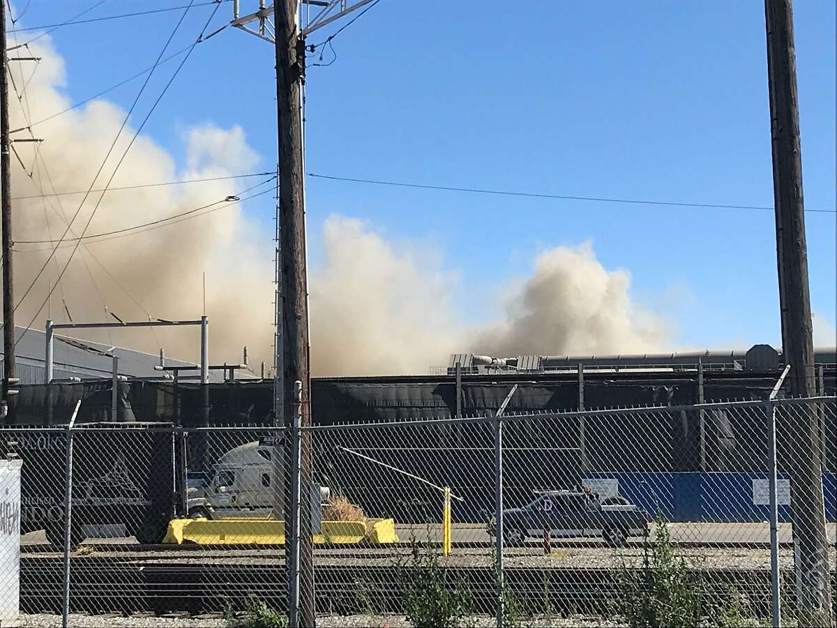 Firefighters were battling a blaze at the Schnitzer Steel recycling facility in Oakland on Wednesday, June 17, 2020.