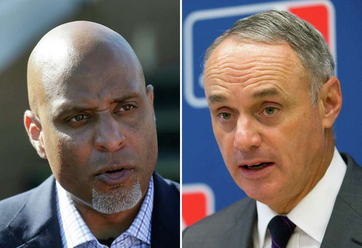 Major League Baseball Players Association chiefTony Clark, left, and MLB commissioner Rob Manfred met for several hours in Phoenix on Tuesday.