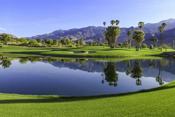 Late afternoon light cast a warm glow to a golf course in Palm Springs, California