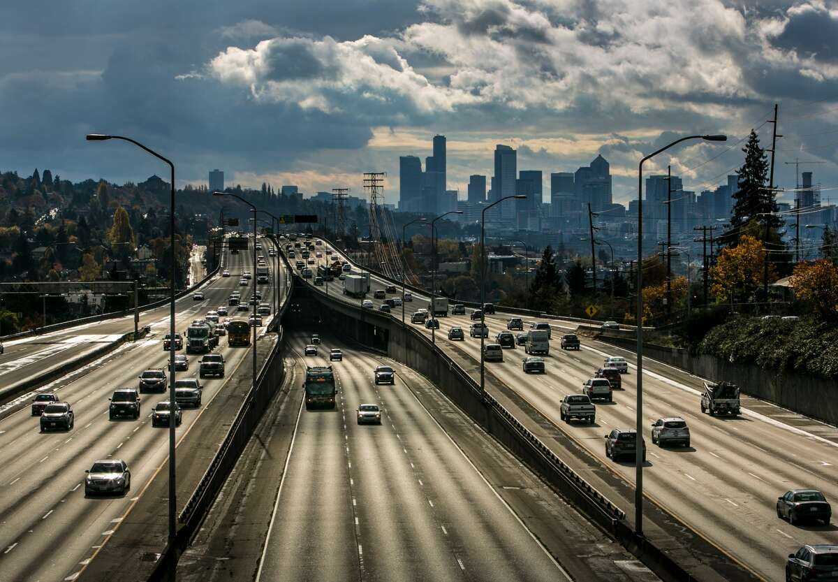SEATTLE, WA - NOVEMBER 3: The downtown skyline is viewed from a bridge over Interstate 5 in the University District on November 3, 2015, in Seattle, Washington. Seattle, located in King County, is the largest city in the Pacific Northwest, and is experiencing an economic boom as a result of its European and Asian global business connections. (Photo by George Rose/Getty Images)