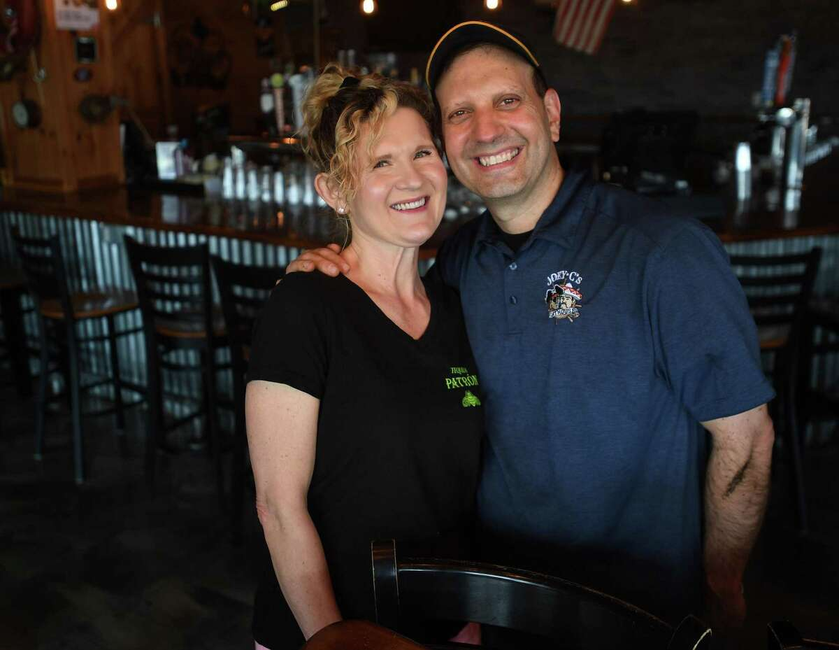 Owners Ania and Joe Catalano on the first day of Phase II reopening at Joey C's Boathouse in Stratford, Conn. on Wednesday, June 17, 2020. The restaurant, which features a large deck seating area, only plans on seating customers indoors during inclement weather.
