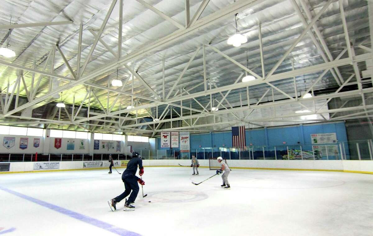 Hockey players practice at Wonderland of Ice in Bridgeport, Conn., on Wednesday June 17, 2020. The facility opened today for the first since the start of the coronavirus pandemic. Down the ramp, hockey players Charlie Leddy and Connor Colucci, both of Fairfield, were shaking the rust after a few months off ice skates.