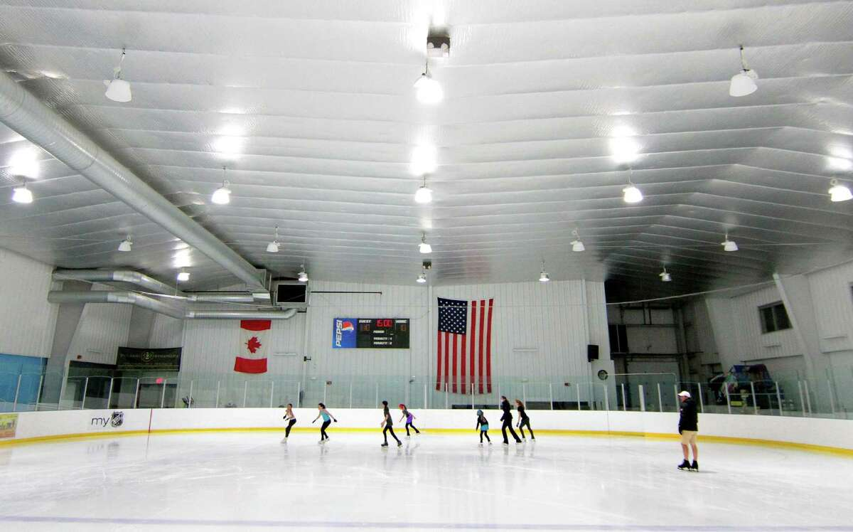 For the first since the start of the coronavirus pandemic, Wonderland of Ice has reopened in Bridgeport, Conn., on Wednesday June 17, 2020. On one rink was a group of young hockey players. On the other, a young group of mostly figure skaters from New Jersey. It won't make up for the Wonderland of Ice missing three months of skating, but Connecticut's phase-two reopening helped put a few more people on the ice in what's usually a bit of a lull time before things pick back up in July.