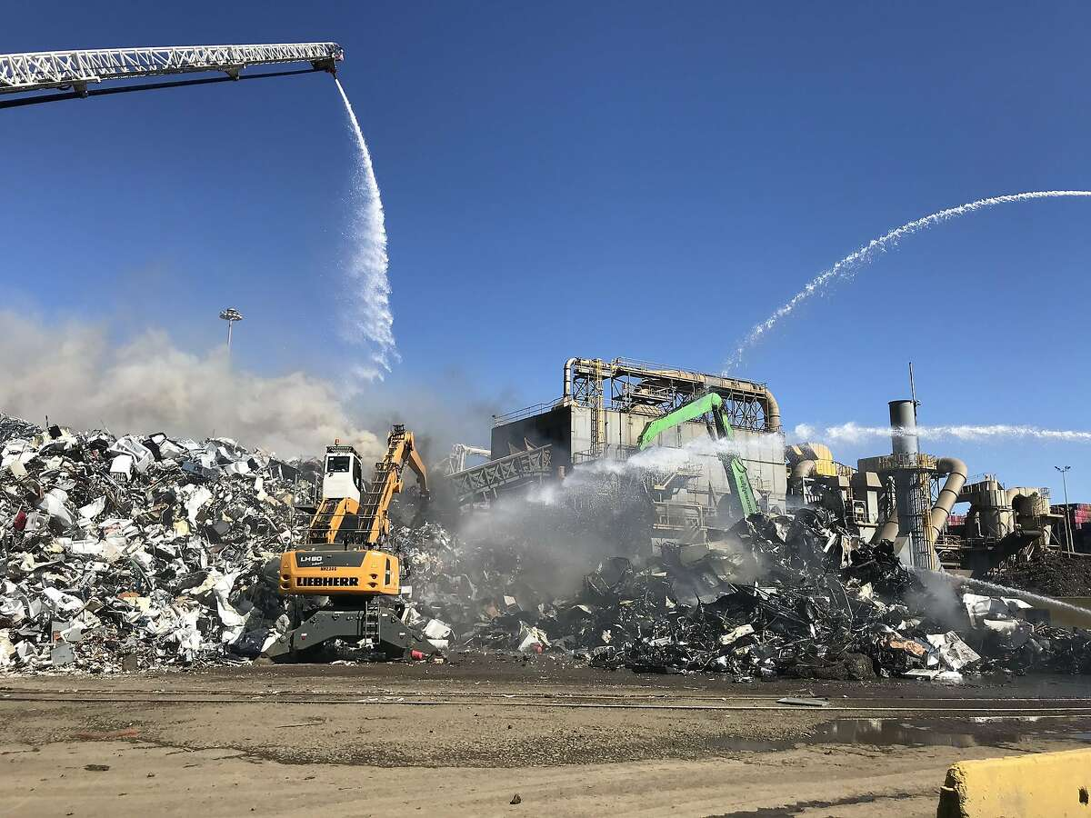 Oakland firefighters contained a blaze that burned metal debris at�the�Schnitzer�Steel recycling facility in Oakland on Wednesday, June 17, 2020.
